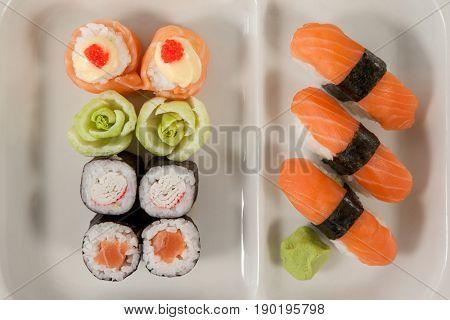 Close-up of uramaki and nigiri sushi served in white plate