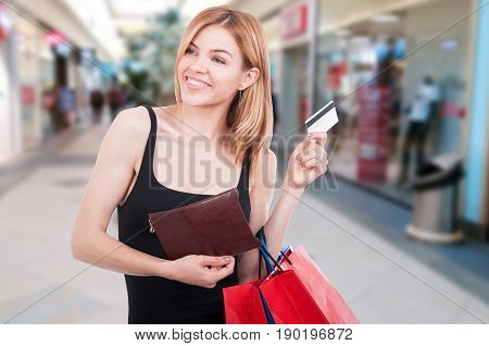 Female Shopper Holding Shopping Bags And Debit Card