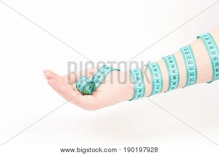 Arm And Hand Of A Woman Wrapped Around With Cyan Measuring Tape