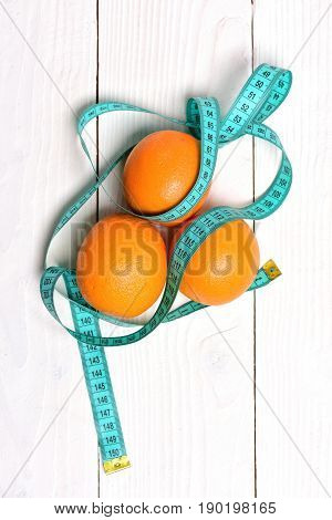 Orange Trio Wrapped With Cyan Measuring Tape