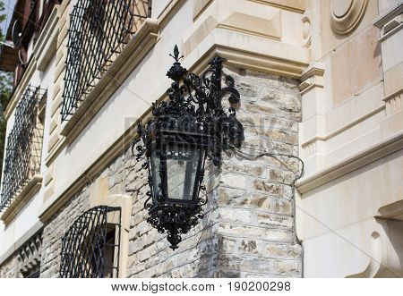 old vintage forged lantern at facade front side of an ancient medieval Peles Castle at Romania