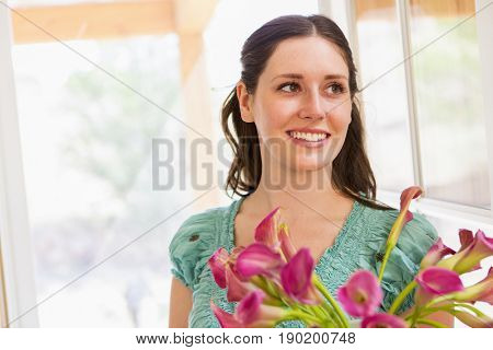 Caucasian woman holding flowers