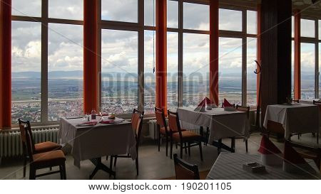 little tables at small restaurant with incredible overlooking sky cloud at old European town city Brasov Romania