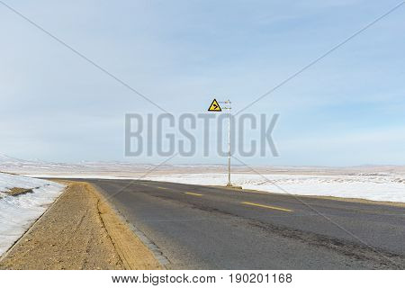 turning road on snow covered tibet plateau