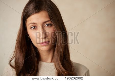 Face of attractive unsmiling woman looking at camera