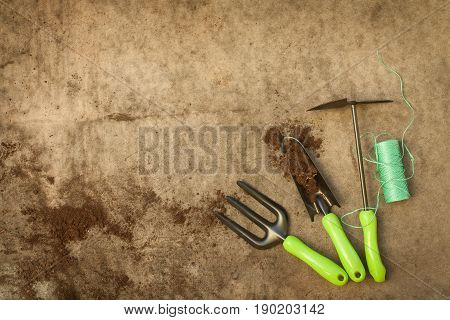 Garden Tools: Fork Scoop With Ground Hoe And Roll Rope On Old Dirt Wooden Gray Board With Copyspace Top View.