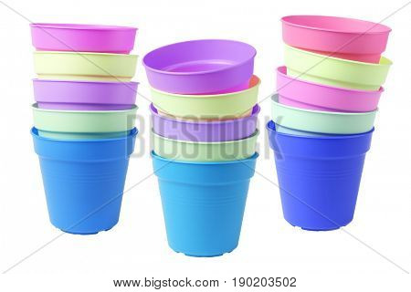 Stacks of Colourful Plastic Flower Pots on White Background
