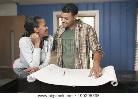 Couple looking at blueprints together