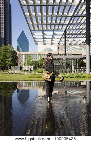 Caucasian woman in urban park, Dallas, Texas, United States