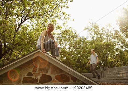 Friends walking on roof