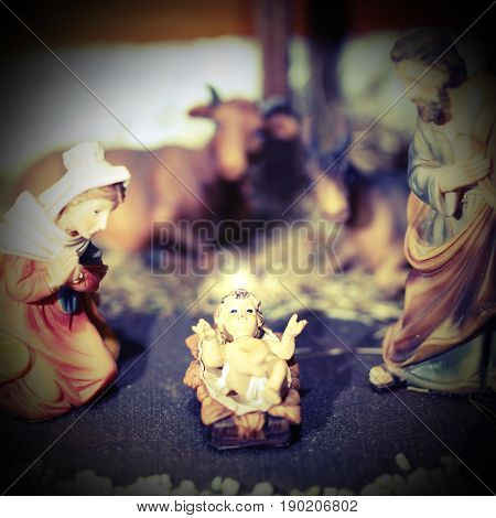 Crib With Jesus Child Who Emits A White Glow