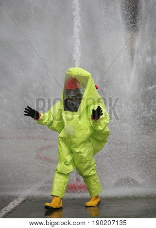 Man With Yellow Protective Suit Against  Chemical Agents And Spl