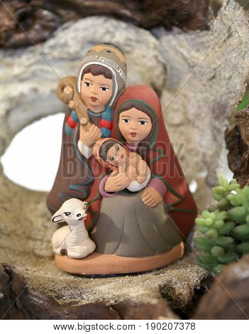 Peruvian Family Symbolizing The Holy Family Of Jesus In Earthenw
