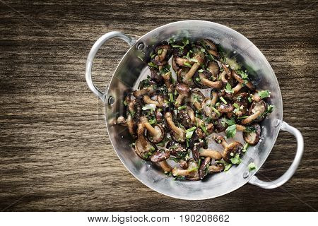 fried shiitake mushrooms in garlic herb and olive oil tapas snack