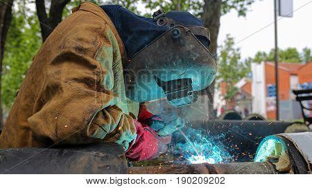 Welding Work. Worker with protective mask welding metal.