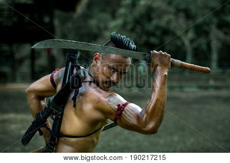 Ancient warrior man of soldier of Bang Rachan District Thailand hold sword ready fighter