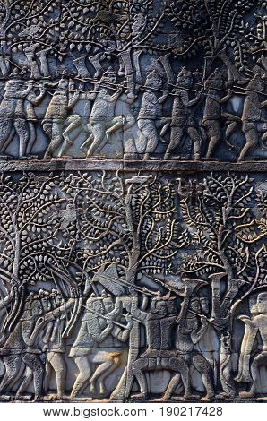 Details of the Bayon is a well-known Khmer temple at Angkor in Cambodia. Built in the late 12th century or early 13th century as the official state temple of the Mahayana Buddhist King Jayavarman VII,