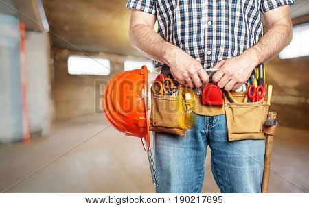 handyman ready for work at construction site