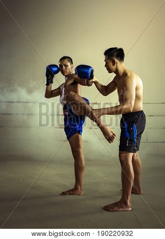 Martial Art Muay Thai Coach Training Kickboxing in Muay Thai Gym.