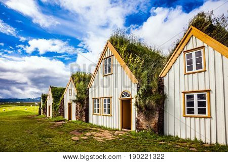 The picturesque village of old houses covered with turf and grass. Ethnographic Museum-estate Glaumbaer, Iceland.The concept of the ethnographic and cultural tourism