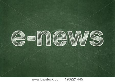 News concept: text E-news on Green chalkboard background