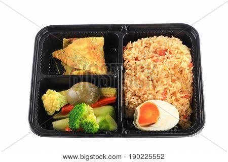 close up fried rice with egg and vegetables in lunch box set on white background