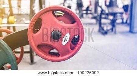 Big red heavy weights for lifting for sportive and active people