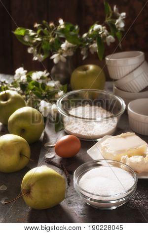 Ingredients for Apple tarte tatena side view vertical