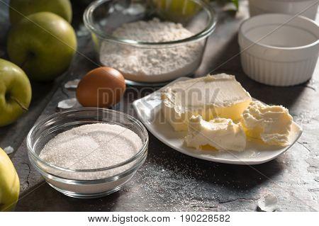 Ingredients for Apple pie tarte tatena side view horizontal