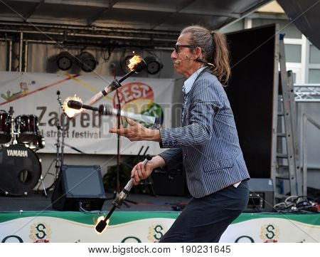 ZAGREB - MAY 2017 : Cest is d`Best famous street festival with many performers on May 2017 in Zagreb. Andy Snatch performer doing his performance play