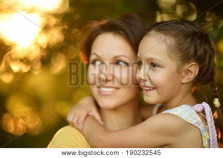 Mother with little daughter on wheat field