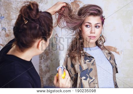 Fixing Hairs With Hairspray