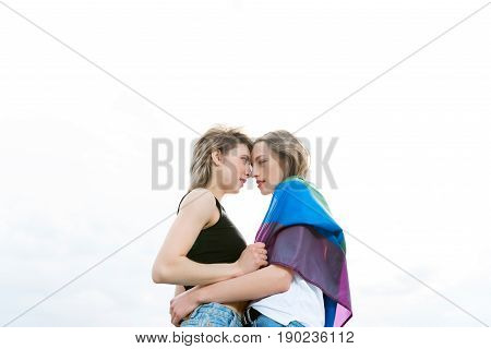 Sensual Homosexual Couple Embracing With Lgbt Flag Outdoors