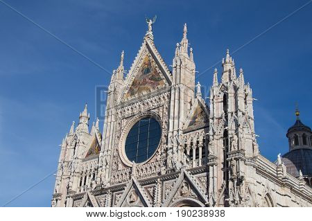 Italy Siena - December 26 2016: the view of upper facade detail of Duomo di Siena or Metropolitan Cathedral of Santa Maria Assunta on December 26 2016 in Siena Tuscany Italy.