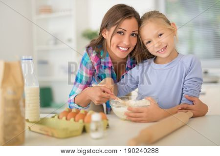 Mother And Daugter In Kitchen
