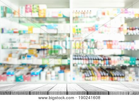Wooden tabletop with blurred of pharmacy shop
