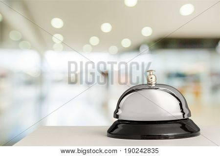 Bell service desk reception hotel table background