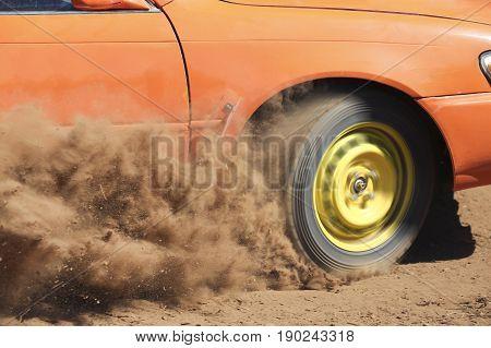 Rally Car turning in dirt track , dust splash