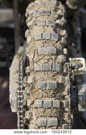 Tire of motocross bike  dirt  on after rest