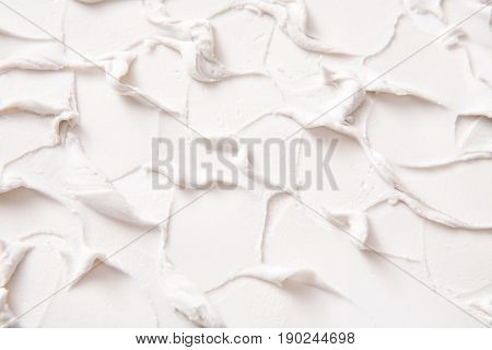 Decorative plaster texture, white relief background with copy space. Stucco surface with abstract pattern. Repair, design, construction concept