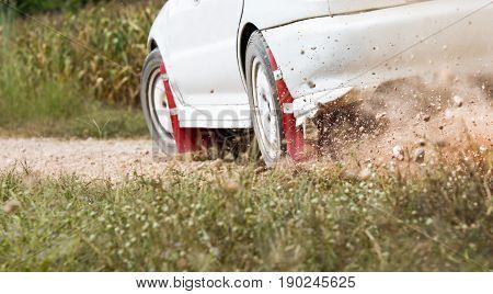 Rally Car turning in track durst splash