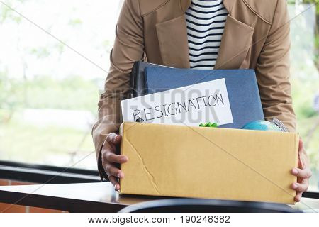 Businesswoman Resignation Packing Up All Her Personal Belongings And Files Into A Brown Cardboard Bo