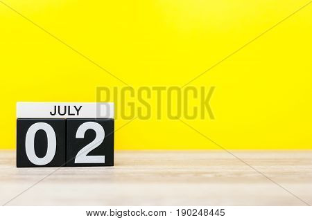 July 2nd. Image of july 2, calendar on yellow background. Summer time. With empty space for text.
