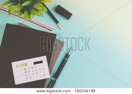 Top View. Modern School Office Desk Table With Modern School Supplies Book, Pen Ruler And Calculator