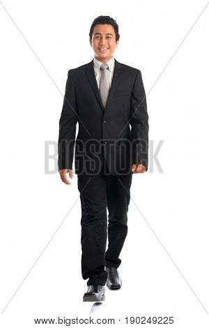 Full body attractive young Southeast Asian businessman walking, isolated on white background. Asian malay male model.