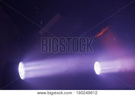 Purple Spot Lights With Strong Beams In Smoke