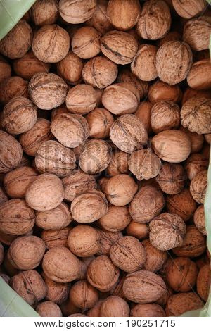 Walnuts background. Walnuts texture. Group walnuts on wooden background.