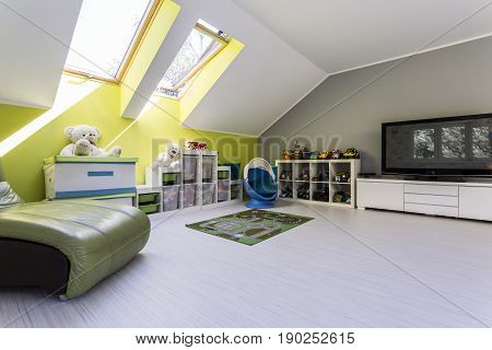 Child Room At The Attic With Tv Set