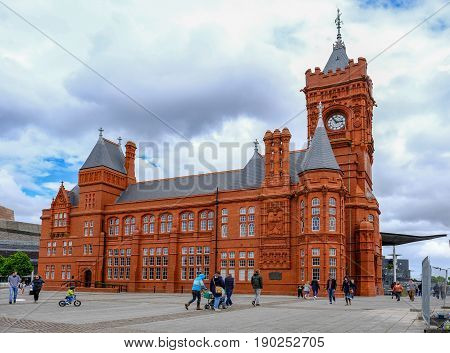 Cardiff Bay Cardiff Wales - May 20 2017: Pierhead builiding with people walking around the square.