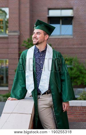 College student graduation lifestyle portrait on campus at a university.